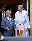 Washington, DC - January 4, 2009 -- United States President George W. Bush (L) talks to Reverend Dr. Luis Leon as he leaves Sunday service at Saint John's Church in Washington on Sunday, January 4, 2009. .Credit: Kevin Dietsch - Pool via CNP