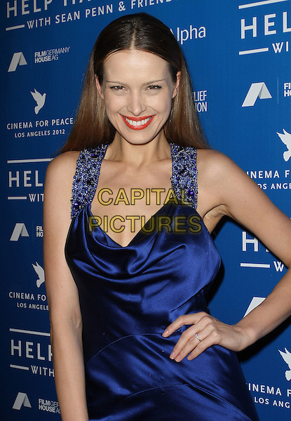 Petra Nemcova.Sean Penn And Friends Cinema For Peace Event Benefiting J/P Haitian Relief Organization held at the Montage Hotel, Beverly Hills, California, USA..January 14th, 2012  .half length blue silk satin dress hand on hip red lipstick beads beaded straps.CAP/ADM/KB.©Kevan Brooks/AdMedia/Capital Pictures.