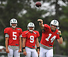 Ryan Fitzpatrick #14, New York Jets starting quarterback, right, throws a pass alongside #5 Christian Hackenberg, left, and #9 Bryce Petty during team training camp at Atlantic Health Jets Training Center in Florham Park, NJ on Tuesday, Aug. 2, 2016.