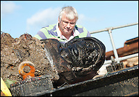BNPS.co.uk (01202) 558833<br /> Picture: Peter Willows<br /> <br /> **Please use byline**<br /> <br /> Marine archeologist David Parham from Bournemouth Universtiy inspects the carving at the top of the rudder from of the 130ft long merchant vessel, which would have been one of the largest of its kind on the seas at the time.<br /> <br /> A spectacular carving of the face of a moustachioed warrior today greeted archeologists as they raised part of a huge 17th century ship wreck in the English Channel. The intricate work of art was engraved into the 28ft long rudder section of the Dutch wooden trading ship that sunk off Poole, Dorset, in 1628. Its accidental discovery by a dredger led to six years of underwater investigations which prompted experts to hail the find as the most significant since the Mary Rose.