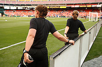 Referees stretch before the game. The women's national team of the United States defeated Canada 6-0 during an international friendly at Robert F. Kennedy Memorial Stadium in Washington, D. C., on May 10, 2008.