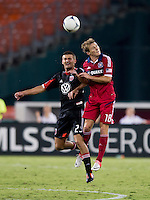 Perry Kitchen (23) of D.C. United goes up for a header with Chris Rolfe (18) of the Chicago Fire at RFK Stadium in Washington, DC.  D.C. United defeated the Chicago Fire, 4-2.