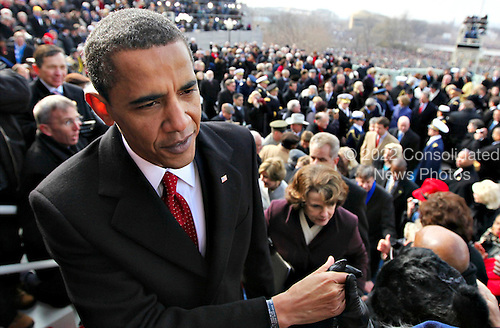 Washington, DC - January 20, 2009 -- United States President Barack Obama greets guest after he is sworn-in as the 44th president of the United States and the first African-American to lead the nation, at the Capitol in Washington, Tuesday, January 20, 2009.      .Credit: J. Scott Applewhite - Pool via CNP