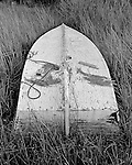 Ruined skiff in a marsh on Harkers Island is testimony of the rough handling a wooden boat can experience.