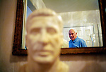 Former Chicago Cardinals football player Charley Trippi was inducted into the College Football Hall of Fame and the Pro Football Hall of Fame during his career in the sport. He is reflected in a mirror next to a bust of himself from the 1968 Pro Hall of Fame in his Athens, Georgia home. KENDRICK BRINSON