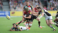 Kelly Brown of Saracens offloads as he is tackled during the Aviva Premiership semi final match between Saracens and Harlequins at Allianz Park on Saturday 17th May 2014 (Photo by Rob Munro)