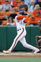 Clemson Tigers  designated hitter Shane Kennedy #11 swings at a pitch during a game against the Virginia Cavaliers  at Doug Kingsmore Stadium on March 15, 2013 in Clemson, South Carolina. The Cavaliers won 6-5.(Tony Farlow/Four Seam Images).