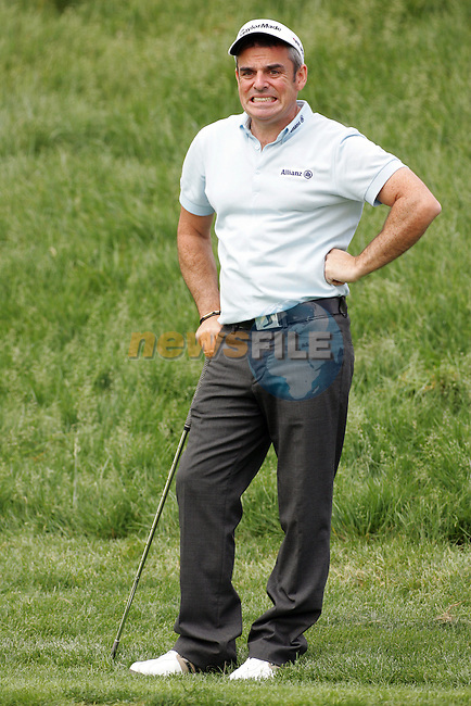 Paul McGinley grimaces after his first chip into the 18th green in the Open de Espana in Madrid...Photo NEWSFILE/Eoin Clarke.(Photo credit should read Eoin Clarke/NEWSFILE)....This Picture has been sent you under the condtions enclosed by:.Newsfile Ltd..The Studio,.Millmount Abbey,.Drogheda,.Co Meath..Ireland..Tel: +353(0)41-9871240.Fax: +353(0)41-9871260.GSM: +353(0)86-2500958.email: pictures@newsfile.ie.www.newsfile.ie.FTP: 193.120.102.198..