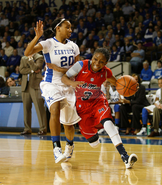 UK's Maegen Conwright defends Ole Miss's Valencia McFarland at Memorial Coliseum on Thursday, Feb. 2, 2012. Photo by Scott Hannigan | Staff