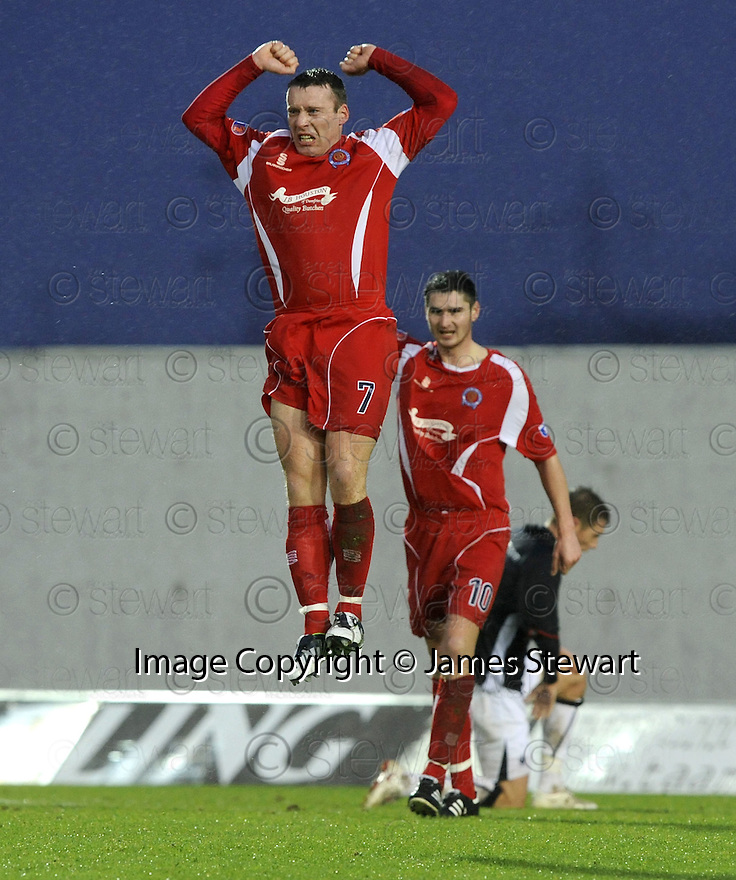 10/01/2009  Copyright Pic: James Stewart.File Name : sct_jspa05_falkirk_v_qots.BARRY WILSON CELEBRATES AFTER HE SCORES QUEEN OF THE SOUTH'S FIRST.James Stewart Photo Agency 19 Carronlea Drive, Falkirk. FK2 8DN      Vat Reg No. 607 6932 25.Studio      : +44 (0)1324 611191 .Mobile      : +44 (0)7721 416997.E-mail  :  jim@jspa.co.uk.If you require further information then contact Jim Stewart on any of the numbers above.........