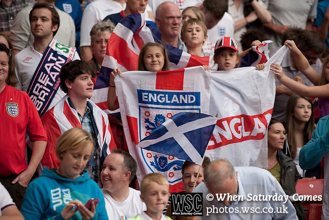 Uruguay 2 United Arab Emirates 1, Great Britain 1 Senegal 1, 26/07/2012. Old Trafford, Olympic Games. Supporters of the Great Britain football team waving flags inside Manchester United's Old Trafford stadium prior to their team's Men's Olympic Football tournament match at the venue. The double header of matches resulted in Uruguay defeating the United Arab Emirates by 2-1 while Great Britain and Senegal drew 1-1. Over 72,000 spectators attended the two Group A matches. Photo by Colin McPherson.