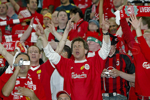25 May 2005: Liverpool supporters singing in the crowd before their UEFA Champions League Final victory over AC Milan played at the Ataturk Olympic Stadium, Istanbul, Turkey. Liverpool beat AC Milan 3-2 on penalties after the game finished 3-3 after extra time, and lifted the European Cup for the fifth time. Photo: Neil Tingle/actionplus..050525 football soccer fans