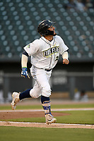 Right fielder Jay Jabs (21) of the Columbia Fireflies runs out a batted ball during a game against the Charleston RiverDogs on Wednesday, August 29, 2018, at Spirit Communications Park in Columbia, South Carolina. Charleston won, 6-1. (Tom Priddy/Four Seam Images)