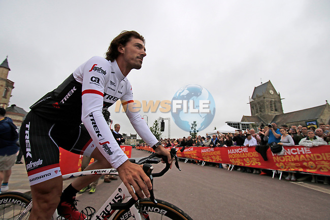 Fabian Cancellara (SUI) Trek-Segafredo team arrives for the team presentations before the start of the 2016 Tour de France, Sainte-Mere-Eglise, France . 30th June 2016.<br /> Picture: Eoin Clarke | Newsfile<br /> <br /> <br /> All photos usage must carry mandatory copyright credit (&copy; Newsfile | Eoin Clarke)
