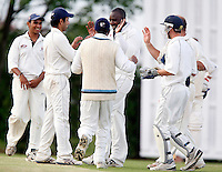 Wembley captain Adrian Green (C) celebrates with team mates after taking a catch to dismiss J Kee during the Middlesex County League Division three game between Wembley and North London at Vale Farm, Wembley on Sat August 6, 2011