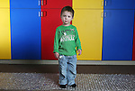 Stride Learning Center preschool student Xander Walsh, 2, looks curious during a portrait session at the school earlier this month. Michael Smith/staff