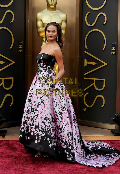 HOLLYWOOD, CA - MARCH 2: Christine Teigen arriving to the 2014 Oscars at the Hollywood and Highland Center in Hollywood, California. March 2, 2014.  <br /> CAP/MPI/mpi99<br /> &copy;mpi99/MediaPunch/Capital Pictures