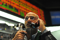A trader on the floor of the Chicago Mercantile Exchange in Chicago, Illinois on September 18, 2008.  As a week of financial uncertainty has sent the stock market tumbling, commodities prices have soared as investors flock to the safer investments like gold.
