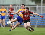 David Tubridy of  Clare in action against Niall Donnelly of Down during their Division 2, Round 2 National League game at Cusack Park. Photograph by John Kelly.
