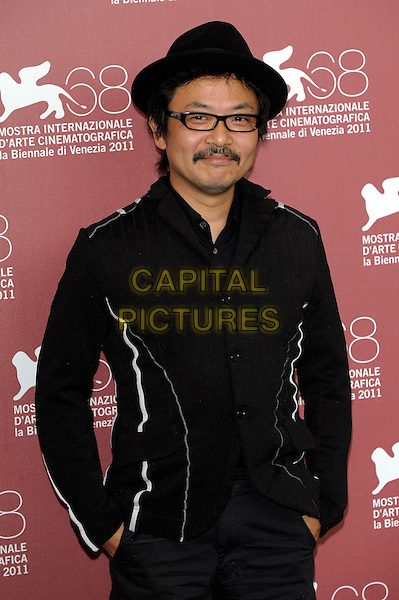 Sion Sono.'Himizu' photocall 68th Venice Film Festival, Italy 5th September 2011.Shion Sono half length jacket black hat glasses  moustache mustache facial hair .CAP/PL.©Phil Loftus/Capital Pictures.