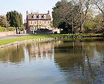 Village duck pond and historic house, in the village of Urchfont, Wiltshire, England.