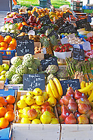 Market stalls with fruits and vegetables, apples, oranges, colourful Sanary Var Cote d'Azur France