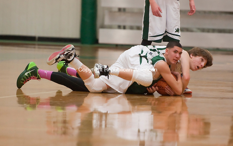 WATERBURY, CT-020114JS23-Forman's Kyle Budlow (1) and Chase's A. J. Vazquez (9) look for a call after both diving for a loose ball during their game Saturday at Chase Collegiate's Goss Field House in Waterbury. <br /> Jim Shannon Republican-American
