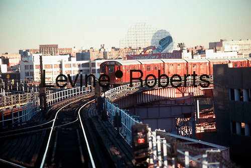 "A Number 7 Flushing Line Elevated Train consisting of ""Redbird"" cars arrives at the Queensboro Plaza Station in this file photo. The ""Redbirds"" were decommissioned in 2003 and after being stripped of recyclable and hazardous materials were sold as artifical reef material. (© Richard B. Levine)"