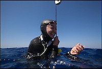 BNPS.co.uk (01202 558833)<br /> Pic: DaanVerhoeven/BNPS<br /> <br /> ***Please Use Full Byline***<br /> <br /> <br /> Big breath - Liv celebrates after making it back to the surface after her 55 metre dive.<br /> <br /> A British woman is celebrating after being crowned world champion in freediving.<br /> <br /> Liv Philip scored 306 points in three different disciplines to win the competition, 84 points ahead of her nearest rival. <br /> <br /> Freediving relies on a diver's ability to hold their breath until resurfacing and not using any apparatus, such as scuba gear. <br /> <br /> To win the competition the 39-year-old competed in three depth disciplines: constant weight to 55 metres, where a freediver swims up and down a line using a monofin, free immersion to 50 metres, where a diver pulls up and down the line, and constant weight no fins to 40 metres, where the diver propels themselves with just their arms and legs.<br /> <br /> The World Cup event is made up of two events - the Mediterranean Cup in June and the Eurocup this month - and Liv got the highest score at both events in Greece to win the overall World Cup.<br /> <br /> She has been the British Freediving Champion seven times and won a bronze medal at the World Championships last year. She is currently in Sardinia for the Team World Championship.