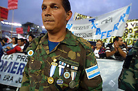 A Argentinean Veteran of Falklands (Malvinas) war takes part in a campaign rally supporting Carlos Menem, one of the three Peronist Party candidates in Buenos Aires, April 24, 2003. Argentina is holding general elections next Sunday with no clear winner in different polls. Whoever wins faces formidable challenges in the wake of a meltdown of the country's economy in 2001, ultimately leading to a default on foreign debt. If no candidate wins 45 percent of the vote this Sunday, a second round will be held May 18 between the two top vote getters. Photo by Quique Kierszenbaum