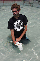 "qa70489-D. marine biologist Steven Kessel from Bimini Biological Field Station puts young Lemon Shark (Negaprion brevirostris) into a relaxed trance-like state called ""tonic immobility"". Bahamas, Atlantic Ocean..Photo Copyright © Brandon Cole. All rights reserved worldwide.  www.brandoncole.com..This photo is NOT free. It is NOT in the public domain. This photo is a Copyrighted Work, registered with the US Copyright Office. .Rights to reproduction of photograph granted only upon payment in full of agreed upon licensing fee. Any use of this photo prior to such payment is an infringement of copyright and punishable by fines up to  $150,000 USD...Brandon Cole.MARINE PHOTOGRAPHY.http://www.brandoncole.com.email: brandoncole@msn.com.4917 N. Boeing Rd..Spokane Valley, WA  99206  USA.tel: 509-535-3489"