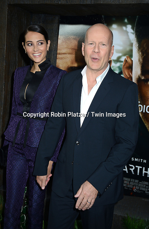 "Emma and Bruce Willis attend the Domestic Premiere of ""After Earth""  on May 29, 2013 at the Ziegfeld Theatre in New York City."