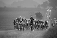 Lars Bak (DEN/Lotto-Belisol) & Ji Cheng (CHN/Giant-Shimano) drive the peleton through a full blown thunderstorm<br /> <br /> 2014 Tour de France<br /> stage 19: Maubourguet - Bergerac (208km)