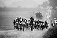 Lars Bak (DEN/Lotto-Belisol) &amp; Ji Cheng (CHN/Giant-Shimano) drive the peleton through a full blown thunderstorm<br /> <br /> 2014 Tour de France<br /> stage 19: Maubourguet - Bergerac (208km)