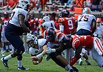 Victor Evans and Marquis Haynes tackle the UT Martin quarterback, Troy Cook, during the game against UT Martin Sat., Sept. 9, 2017. Ole Miss wins 45-23.  Photo by Marlee Crawford/Ole Miss Communications