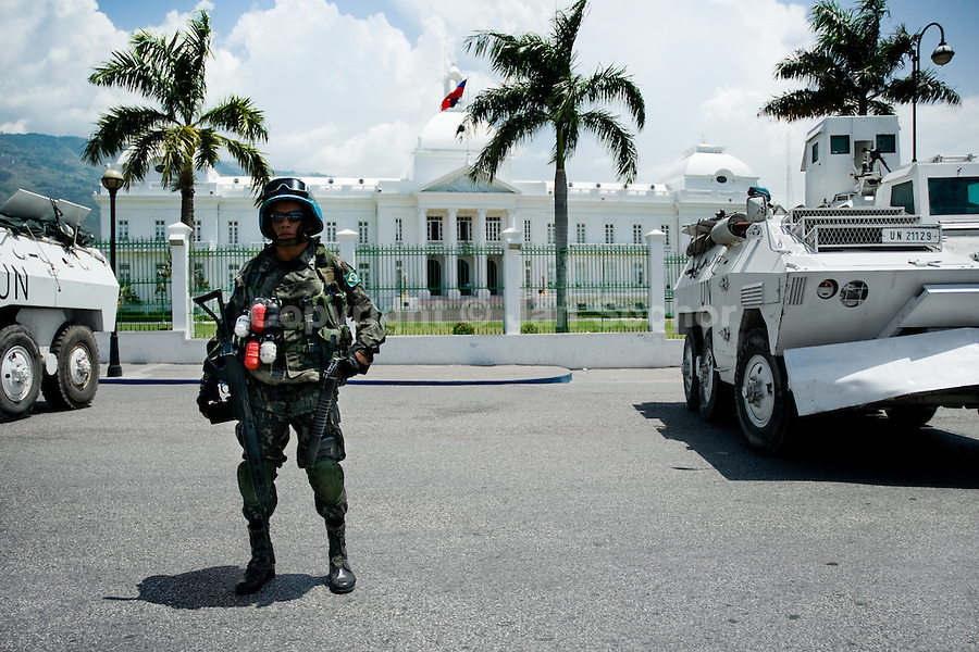 The UN soldier from Brazil guards the Presidential Palace in Port-au-Prince, Haiti. The United Nations Stabilization Mission In Haiti (MINUSTAH) is a peacekeeping mission that has been installed in Haiti in 2004 by the United Nations. In spite of the undoubted efforts that have been made by the UN, MINUSTAH soldiers became a symbol of the occupation and therefore they are generally not welcomed by the Haitian population.