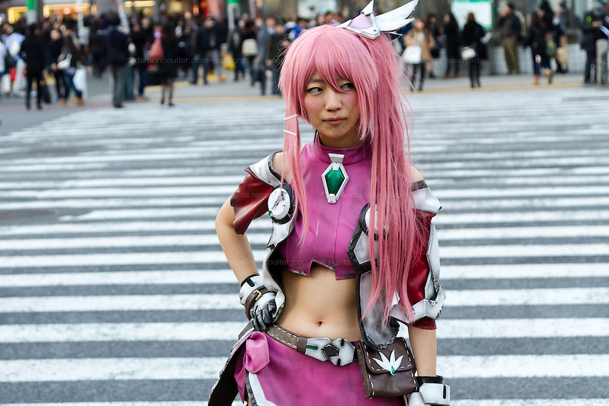 A model in fantasy clothing press at Shibuya crossing in Tokyo, Japan. Friday November 21st 2014