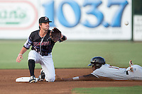 Grant Massey (8) of the Kannapolis Intimidators waits for a throw as Cedric Mullins (11) of the Delmarva Shorebirds steals second base at Kannapolis Intimidators Stadium on June 25, 2016 in Kannapolis, North Carolina.  The Intimidators defeated the Shorebirds 2-1.  (Brian Westerholt/Four Seam Images)