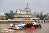City Cruises sightseeing boat on the River Thames, with St Paul's Cathedral behind, South Bank, London, England