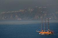 Michael McCollum.6/19/11.A ship travels in the morning sunlight to the island of Santorini , Greece.
