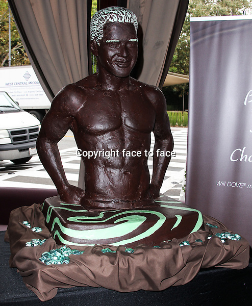 LOS ANGELES, CA - AUGUST 01: Mario Lopez Unveils Life-Size Dove Chocolate Look-A-Like Sculpture At The Grove To Help Launch New Dove Silky Smooth Mint &amp; Dark Chocolate Swirl on August 1, 2013 in Los Angeles, California.<br />