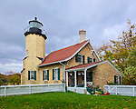 Muskegon County, Michigan: White River Light Station with dark storm clouds.  Located on the mouth of White Lake and Lake Michigan. Built in 1875.