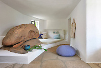 Several rooms in the villa incorporate the granite boulders that litter the landscape