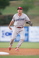 Lakewood BlueClaws first baseman Rhys Hoskins (12) on defense against the Kannapolis Intimidators at CMC-Northeast Stadium on May 16, 2015 in Kannapolis, North Carolina.  The BlueClaws defeated the Intimidators 9-7.  (Brian Westerholt/Four Seam Images)