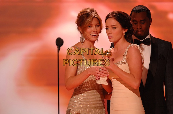 """JESSICA BIEL, EMILY BLUNT & SEAN """"P DIDDY PUFF DADDY"""" COMBS.Accepts the award for Best Performance by an Actress in a Supporting Role in a Series, Mini-Series or Motion Picture Made for Television.Telecast - 64th Annual Golden Globe Awards, Beverly Hills HIlton, Beverly Hills, California, USA..January 15th 2007. .globes stage microphone half length silver white dress blue suit jacket .CAP/AW.Please use accompanying story.Supplied by Capital Pictures.© HFPA"""" and """"64th Golden Globe Awards"""""""