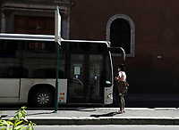 A girls  waits for a bus in central Rome on May 4, 2020 as Italy starts to ease its lockdown, during the countrys lockdown aimed at curbing the spread of the COVID-19 infection, caused by the novel coronavirus.<br /> UPDATE IMAGES PRESS/Isabella Bonotto