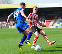 Lincoln City's Harry Toffolo vies for possession with Tranmere Rovers' Kieron Morris<br /> <br /> Photographer Andrew Vaughan/CameraSport<br /> <br /> The EFL Sky Bet League Two - Lincoln City v Tranmere Rovers - Monday 22nd April 2019 - Sincil Bank - Lincoln<br /> <br /> World Copyright © 2019 CameraSport. All rights reserved. 43 Linden Ave. Countesthorpe. Leicester. England. LE8 5PG - Tel: +44 (0) 116 277 4147 - admin@camerasport.com - www.camerasport.com