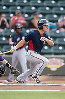 Max Schrock (1) of the Potomac Nationals follows through on his swing against the Winston-Salem Dash at BB&T Ballpark on July 15, 2016 in Winston-Salem, North Carolina.  The Dash defeated the Nationals 10-4.  (Brian Westerholt/Four Seam Images)