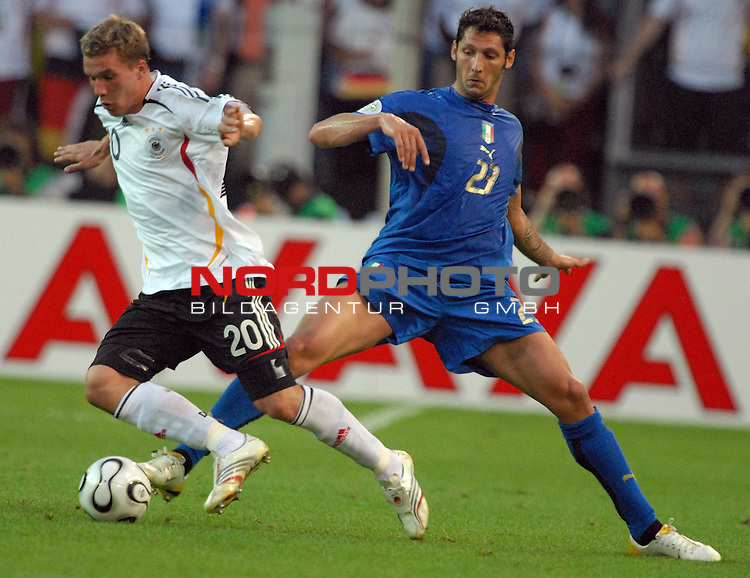 FIFA WM 2006 -  Semi Finals / Halbfinale<br /> <br /> Play    #61 (04-Juli) - Deutschland - Italien<br /> <br /> <br /> <br /> Lukas Podolski (GER) gegen Andrea Pirlo (ITA)<br /> <br /> <br /> <br /> Foto &copy; nordphoto
