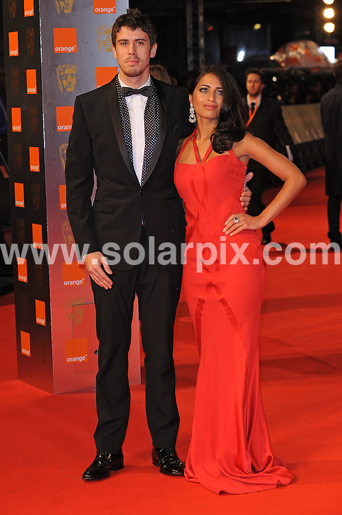 **ALL ROUND PICTURES FROM SOLARPIX.COM**.**WORLDWIDE SYNDICATION RIGHTS**.arrivals for the 2009 Orange British Academy Film Awards, the BAFTAs, held at the Royal Opera House, London, UK. 8 February 2009..This pic: Toby Kebbell and Ruzwana Bashir..JOB REF:  8422 SSD     DATE: 08_02_2009.**MUST CREDIT SOLARPIX.COM OR DOUBLE FEE WILL BE CHARGED**.**ONLINE USAGE FEE  GBP 50.00 PER PICTURE - NOTIFICATION OF USAGE TO PHOTO @ SOLARPIX.COM**